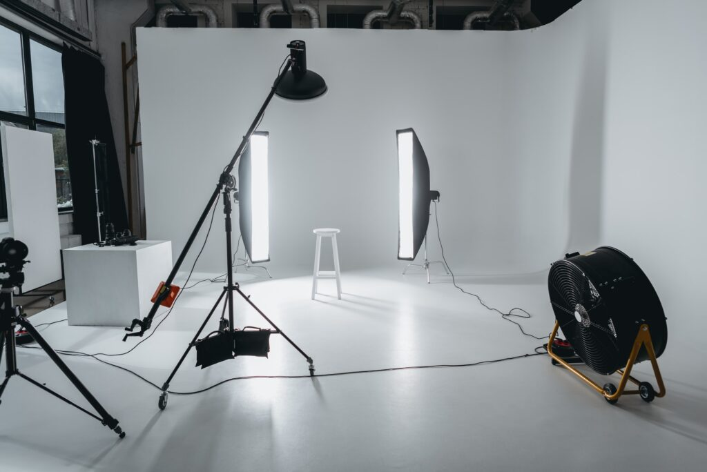 photo studio with lighting equipment and fan